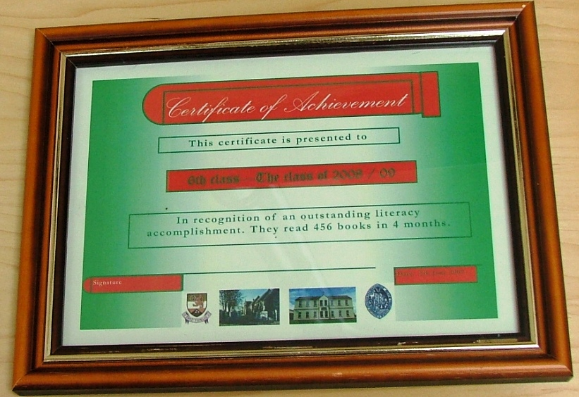Photograph of the certificate awarded to 6th class for boys into books